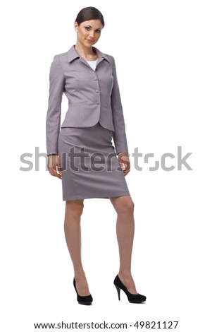 Full length of a young Caucasian business woman on white - stock photo