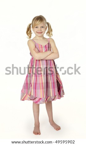 Full length studio photo of six year old girl wearing pink summer dress standing on white background. - stock photo