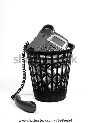 full wastepaper with crumpled papers and old-fashion phone on white background - stock photo