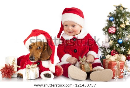 funny small baby in Santa Claus and dog dachshund - stock photo
