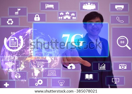 7G  concept  presented by  businessman touching on  virtual  screen ,image element furnished by NASA - stock photo