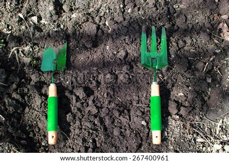 Gardening tools on the ground in backyard - stock photo