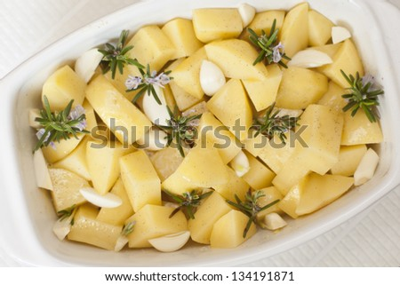 garlic potatoes with sea salt and rosemary. - stock photo