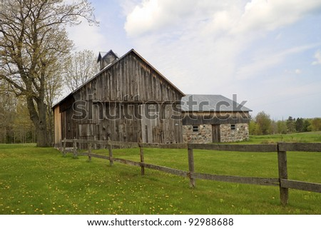 """Gated"" -- A rustic historic barn - Sleeping Bear Dunes National Lake Shore, Port Oneida, Michigan, USA. - stock photo"