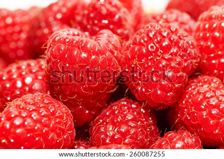 gathered and piled raspberry. small depth of sharpness - stock photo