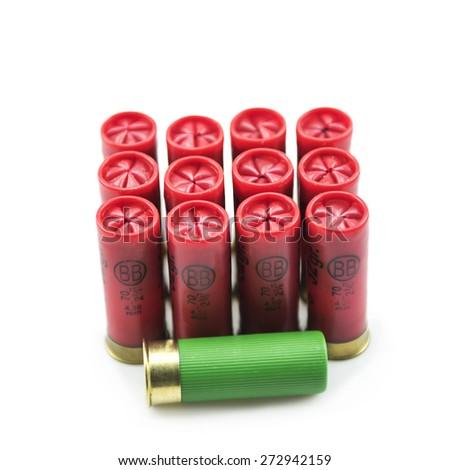 12 gauge shotgun shells isolated on a white background - stock photo