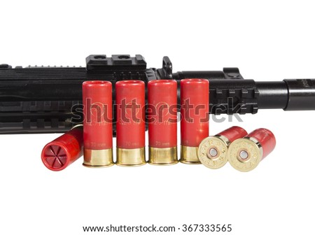 12 gauge shotgun shells with shotgun used for hunting isolated on a white background - stock photo