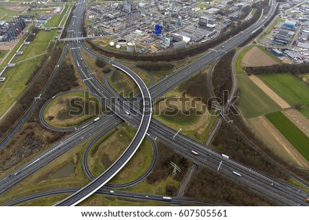 3-3-2017, Geleen, Holland. Aerial view of cloverleaf Kerensheide, the junction at highway A2 and freeway A76 in the province of Limburg. It lies next to the industrial are of Chemelot, owned by DSM.
