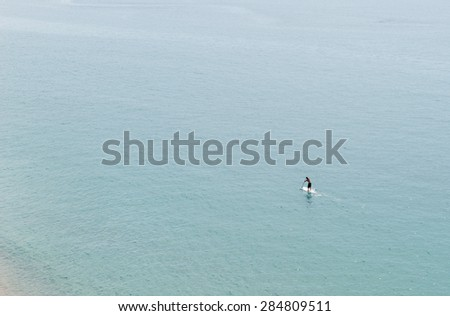 General view of the sea with a person Paddle Surf - stock photo