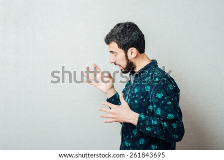 Gesture. Man shouting loudly angry. - stock photo