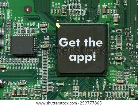 """Get the app!"" sign on computer motherboard - stock photo"