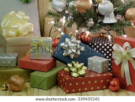 Gift boxes with Christmas tree  on wooden background - stock photo