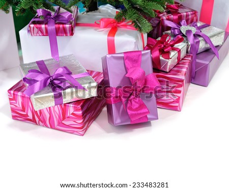 gifts under Christmas tree isolated on white background - stock photo