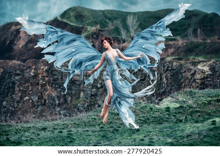 Girl angel with a beautiful wings. As the picture from an old book. Fashionable toning, picture in the style of fantasy. - stock photo