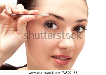 girl, cosmetic beauty, eye brow tweezers treatment,  isolated on white background - stock photo