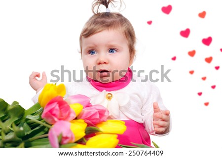 girl in a pink dress with a bouquet of tulips. March 8 Mother's Day - stock photo