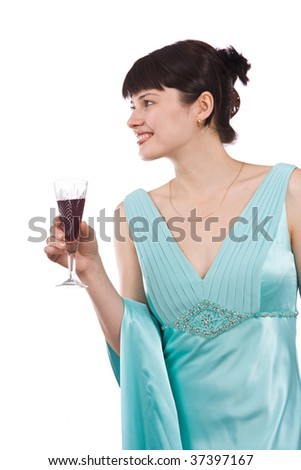 Girl in greenness of the sea dress is standing and holding wine glass. Isolated on white background.