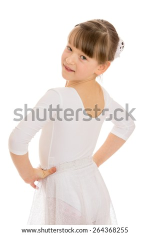 Girl in white gymnastic leotard looks over his shoulder - isolated on white background - stock photo