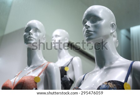 girl mannequins in shop window - stock photo