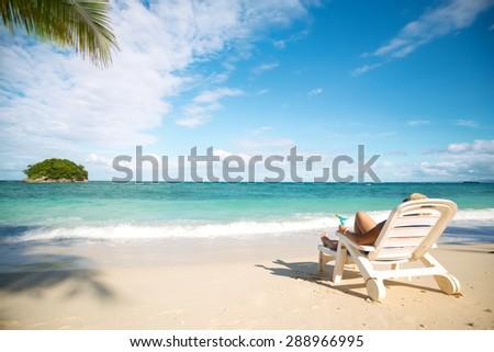 Girl relaxing on the beautiful beach - stock photo