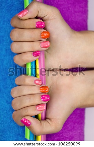 Girl's hands holding colored jelly candy - stock photo