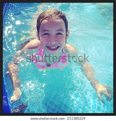 Girl swimming in pool - With Instagram effect