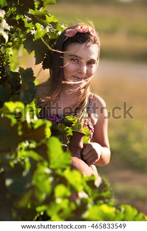 Girl with a jug in the vineyards