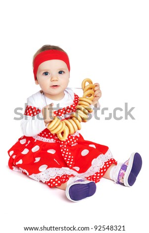 girl with bread-rings - stock photo