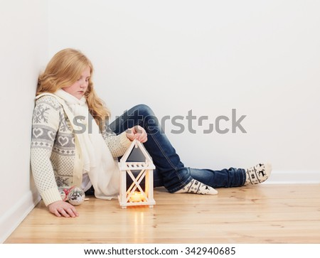 girl with Christmas lantern indoor - stock photo