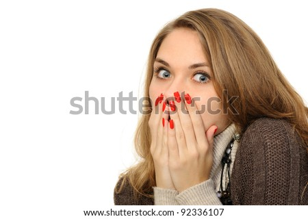 girl with hand over mouth on a white background - stock photo