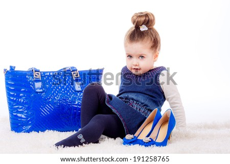 girl with shoes and bag mom. isolated on white background. fashionista, shopping - stock photo