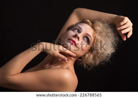 girl with two-faced makeup posing - stock photo