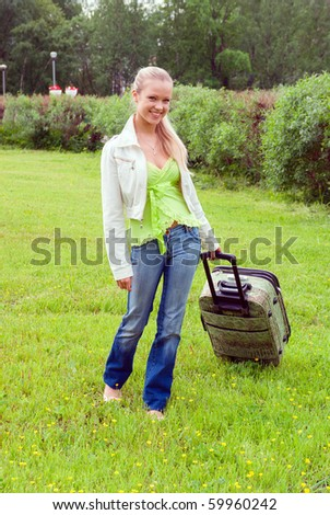 girl with valise.Journey and rest