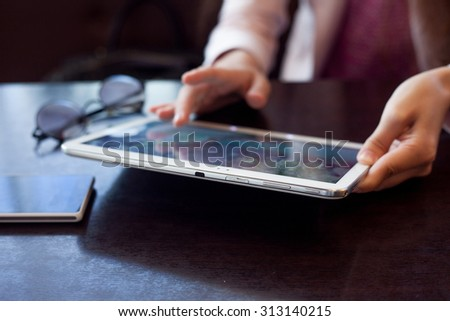 girl works on the digital tablet, a small depth of field, soft focus - stock photo