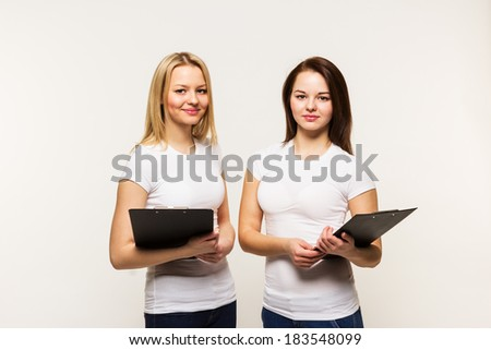 2 girls in t-shirts. - stock photo