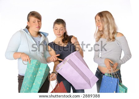 3 girls looking on their shopping bags. - stock photo