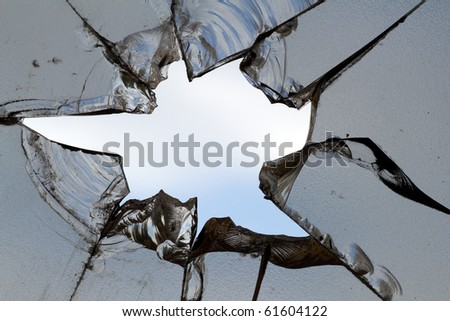 Glass  broken   hole  cracks - stock photo