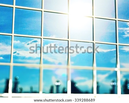 glass building wall in city with blur shadow selective focus - stock photo
