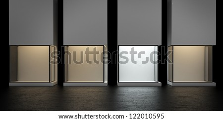 4 glass exhibition stands, one with a white light. 3d render - stock photo