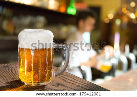 glass of beer in the pub  - stock photo