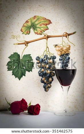 glass of  red wine background grape cluster decorated, romantic moment with red rose ,photo with vignetting, natural light, vertical photo - stock photo