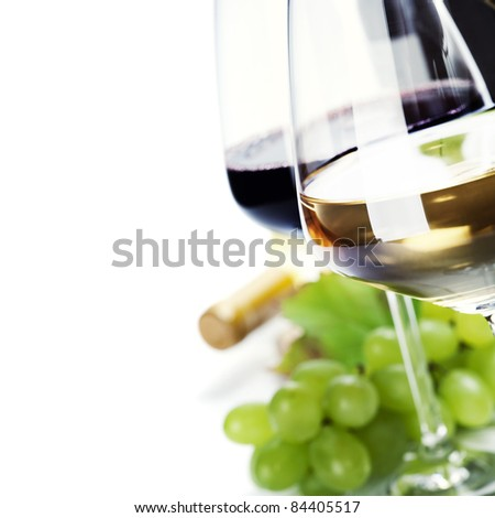 glass of wine and  grape over white - stock photo