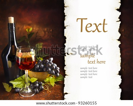 glass of wine with grapes (With sample text) - stock photo