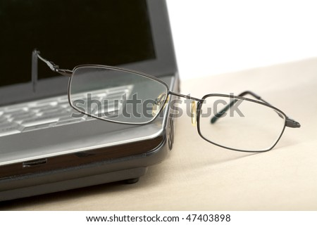 glasses and notebook on a desk