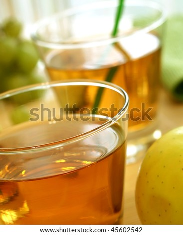 glasses of apple juice - stock photo