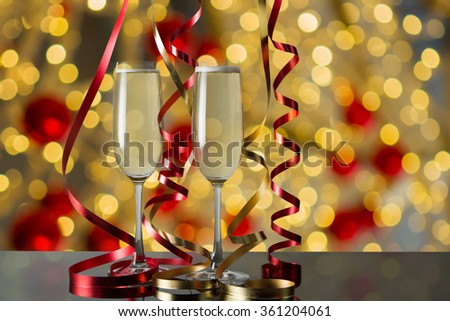 Glasses of champagne for celebrations with abstract bokeh background. - stock photo