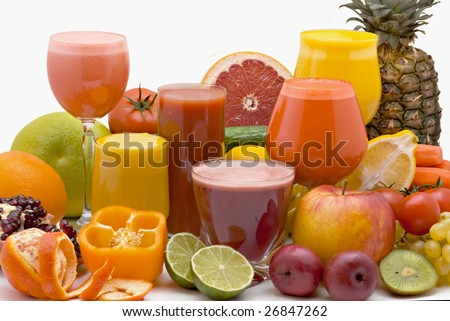 Glasses of fresh juice from different fruit on a white background - stock photo