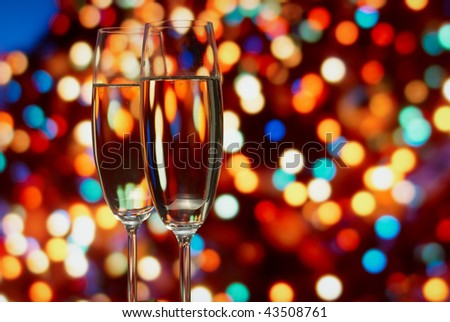 Glasses with champagne on an abstract background - stock photo