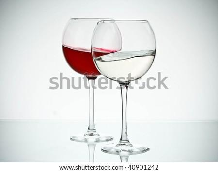 2 glasses with liquid - stock photo