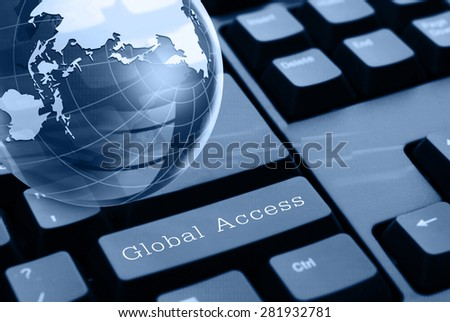 Global communication concept.Glass globe over keyboard.